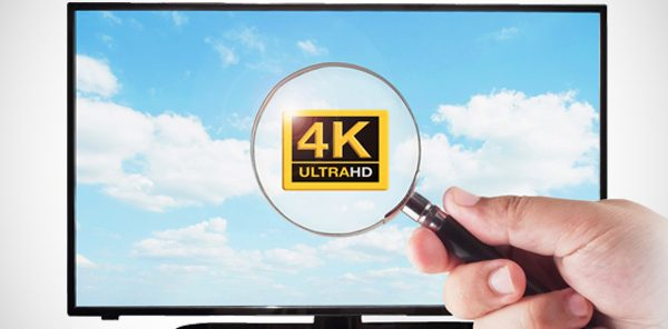 tv with a 4k ultraHD on the screen with a magnify glass over top of it reading